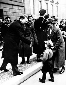 1934. The youngster is wearing the uniform of Hitler's Sturmabteilung.jpg
