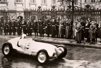 1939, A racing car passing by Hitler.jpg