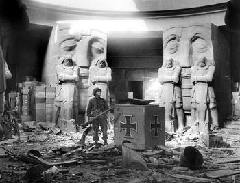 A U.S. soldier stands in the middle of rubble in the Monument of the Battle of the Nations in Leipzig after they attacked the city on April 18, 1945..jpg