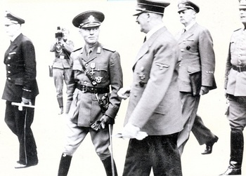 Adolf Hitler with Rumanian Marshal Ion Antonescu. In the background we can see Hitler's interpreter Gustav Paul Schmidt with General Wilhelm Keitel.jpg
