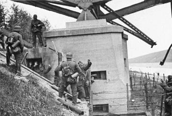 Belgian soldiers surrender to German paratroopers after the Battle of Fort Eben-Emael.jpg