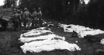 Bodies of U.S. soldiers are attended to in the French countryside, Summer 1944..jpg