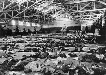 Bombing victims laid out in an exhibition hall, Autumn 1944.JPG