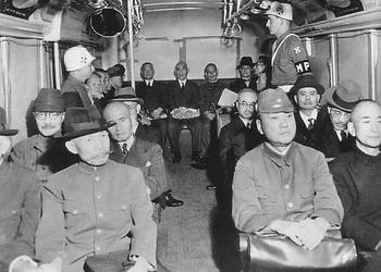 Class-A War Criminals in bus.jpg