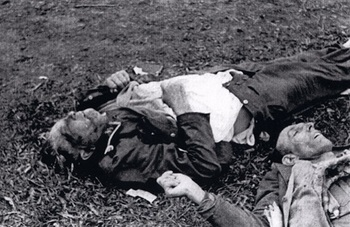 Dead SS soldier and another man at Dachau.jpg