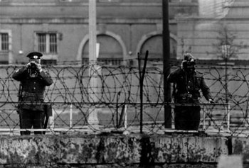 East German guards watching over the Berlin wall 1965.jpg