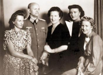 Eva Braun with her parents, Friedrich 'Fritz' and Franziska (centre) and her sisters Ilse (left) and Margarethe Gretl (second from right) in 1940.jpg