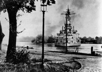 German drill ship Schleswig-Holstein opens fire on the polish bunkers at the Westerplatte, a woody peninsula near Danzig.jpg