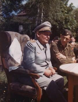 Goring_on_what_appears_to_be_a_subsequent_day,_sitting_down_with_U_S__forces.jpg