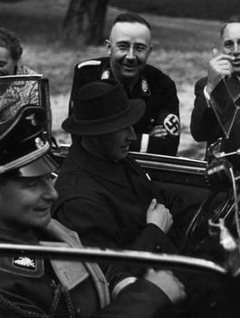 Heinrich Himmler looks on as Heydrich and Himmler's personal adjutant, Karl Wolff.jpg