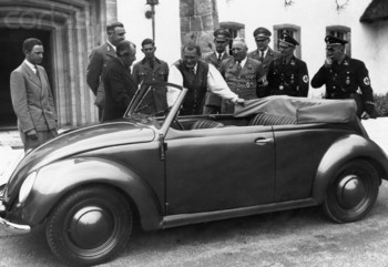 Hermann Goering stands next to a Volkswagen convertible at Carinhall hunting lodge, with Robert Ley and Ferdinand Porsche.jpg