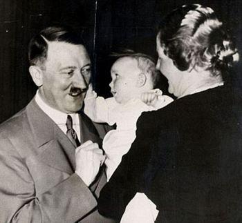 Hitler has his cheek pulled by Edda Goering.jpg