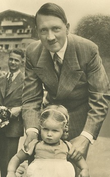 Hitler_with_a_small_visitor_of_Obersalzberg.jpg