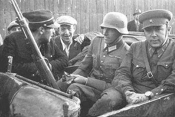 It shows a German, a Russian and a Polish soldier sitting together!.jpg