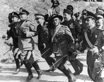 Italian fascist dictator Benito Mussolini leads his officers in a spirited run in full military regalia.jpg