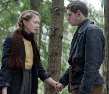 Jamie Bell and Mia Wasikowska in Defiance.jpg