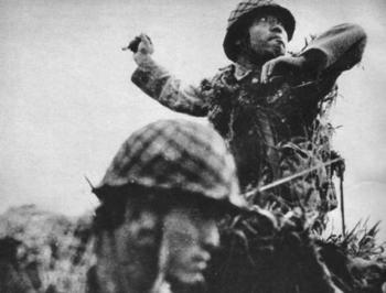 Japanese soldier throwing a Type 91 grenade, Guadalcanal,.jpg