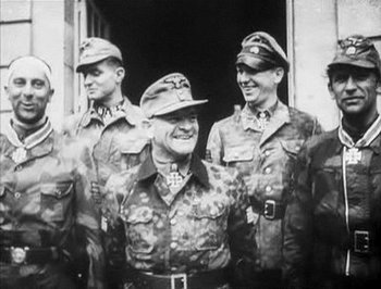 Mohnke_Meyer_ Sepp Dietrich after award decoration in Normandy.jpg