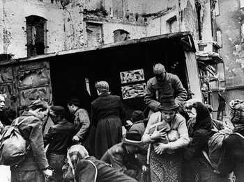 Red Army soldiers distributing bread to Berlin residents after Germany's surrender in 1945.jpg