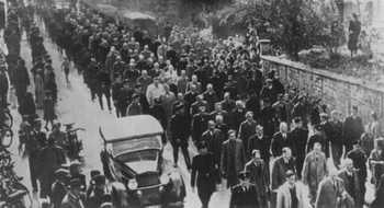 SS guards force Jews.jpg