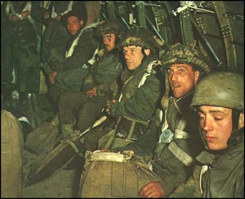 Soldiers waiting to be parachuted in France.jpg