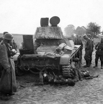 T 26 tank detroyed after a battle with German forces shows the carnage of war.jpg