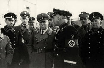 Theodore_Eicke_with_Robert_Ley_during_Dachau_insp_1936.jpg