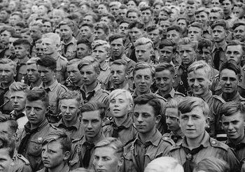 Thousands of young men flocked to hang upon the words of their leader.jpg