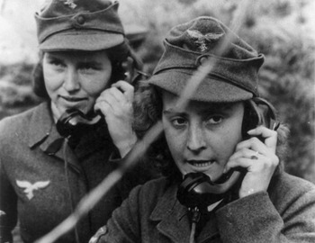 Two women of the German anti-aircraft gun auxiliary operating field telephones during World War II.jpg