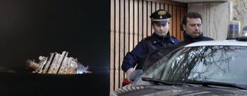 costa-concordia-night_The ship's captain gets into a police car.jpg