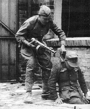 russian-soldier-pulls-out-german-from-amanhole-april-berlin-1945.jpg