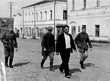 A German patrol caught two disguised Soviet soldiers. September 1941, Kiev, Ukraine..JPG