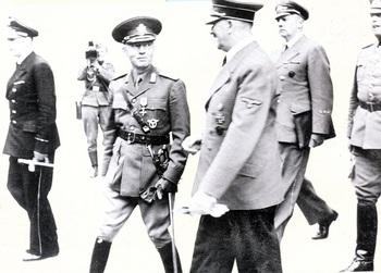 Adolf Hitler with Rumanian Marshal Ion Antonescu. In the background we can see Hitler's interpreter Gustav Paul Schmidt with General Wilhelm Keitel.jpg