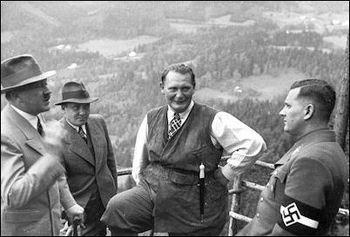 Baldur von Schirach (right) listens to Hitler as Bormann and Göring.jpg