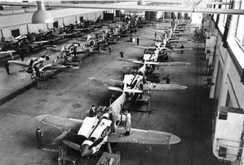 Bf 109G-6s in a German aircraft factory.jpg