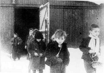Children leave Birkenau barracks after being liberated.jpg