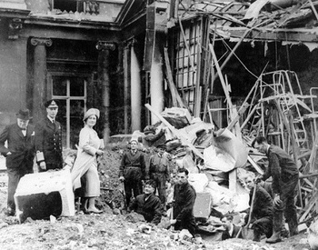 Churchill with King George VI and Queen Elizabeth inspecting the damage caused by bombs which hit Buckingham Palace at the beginning of the Blitz.jpg