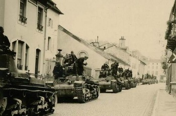 Column of PzKpfw 35(t)s at a stop in a French town-1940.jpg