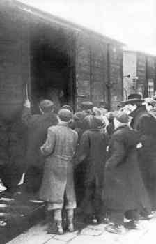 Cracow Jews boarding a boxcar for deportation.jpg