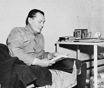 Defendant Herman Goering lies in his bunk in jail during the International Military Tribunal trial of war criminals at Nuremberg.jpg