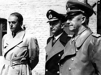 Dr Albert Speer (left), with Admiral Doenitz and Colonel Alfred Jodl after their arrest on 23 May 1945.jpg