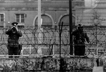 East German guards watching over the Berlin wall 1965.jpg