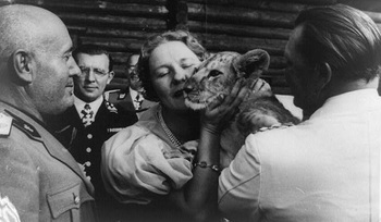 Göring and his wife Emmy showing off pet lion cub to Benito.jpg