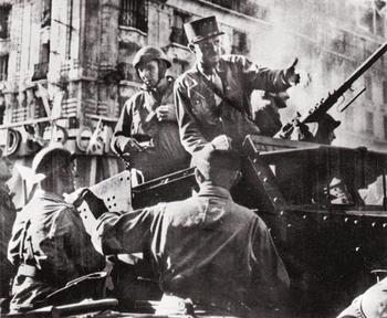 General Jacques Phillippe Leclerc directing French action in Paris from his half-track.jpg