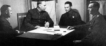 General K. Rokossovsky, Marshal of Artillery N. Voronov, translator captain Diatlenko, and Field Marshal Paulus.jpg