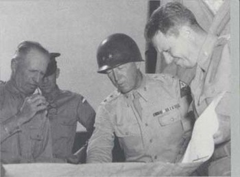 General McNair (left) and Maj. Gen. George S. Patton, Jr., Studying a Map.jpg