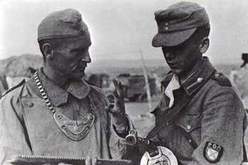 German MP (Feldgendarme) and a soldier of the Russian Liberation Army.jpg