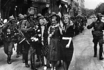 German soldiers greeted by Latvian women in Riga during their occupation - July 1941.jpg