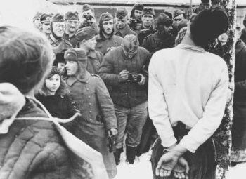 German troops take snaps as an alleged partisan is hanged in a Belarussian town.jpg