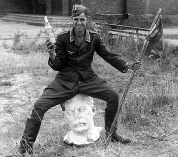 He is enjoying his drink on Stalin's head.jpg
